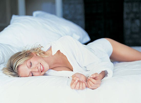 Healthy Woman sleeping on a Haiku Designs Total Sleep System